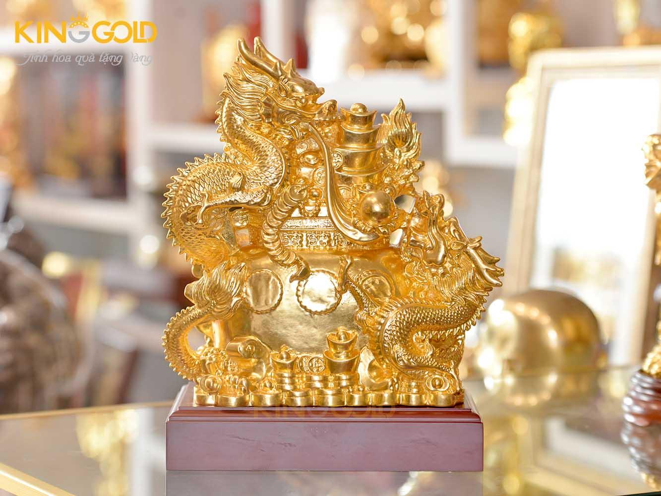Tượng rồng ôm vàng bạc châu báu, tượng rồng vàng phong thủy0